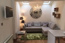 Open plan living space with corner sofa