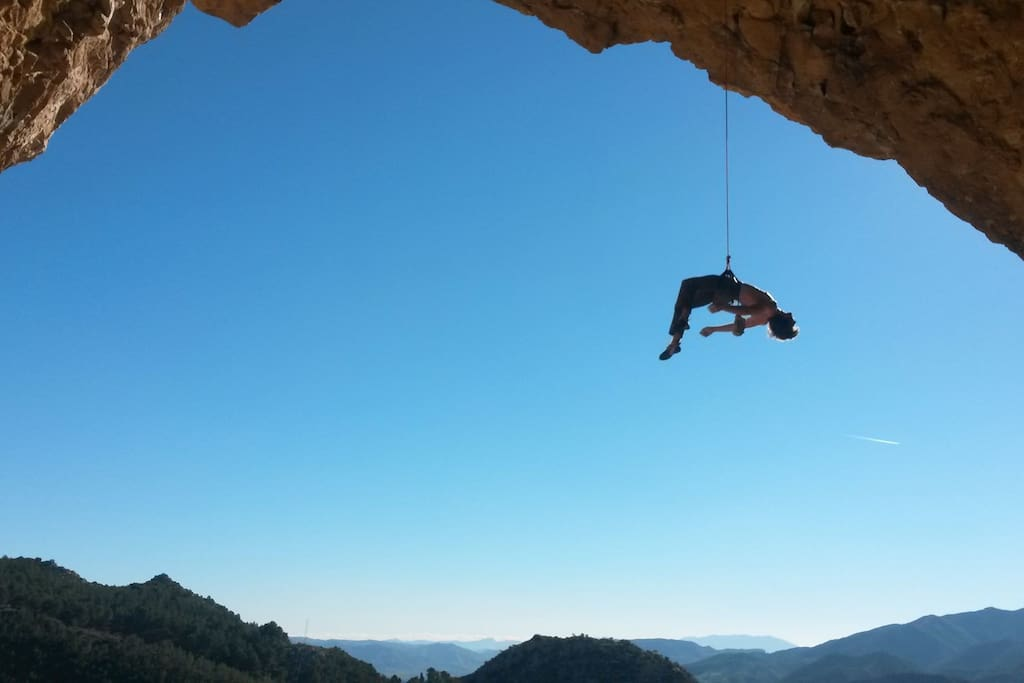Lowering off Swimming through a shark attack, 8a+,  Poema de Rocca, El Chorro