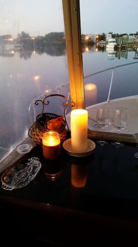 Beautiful candlelit view of the Anclote River. This marina is located at the delta of the Anclote river where the river meets the Gulf of Mexico. It is the closest marina to the gulf in Tarpon Springs and has a nice state park with a modern boat launch next door.