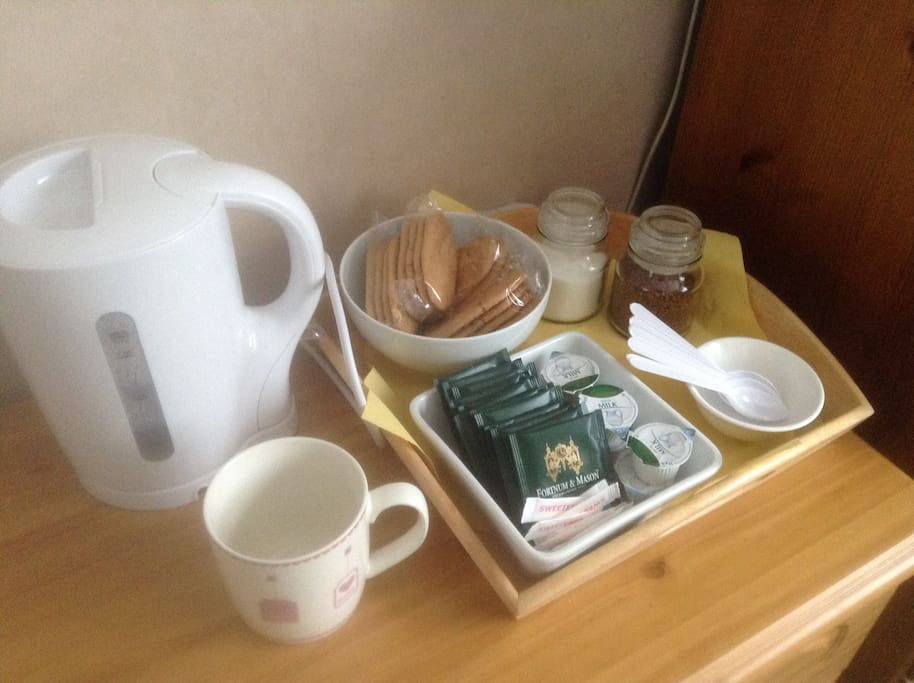 Tea & coffee making facilities in room.