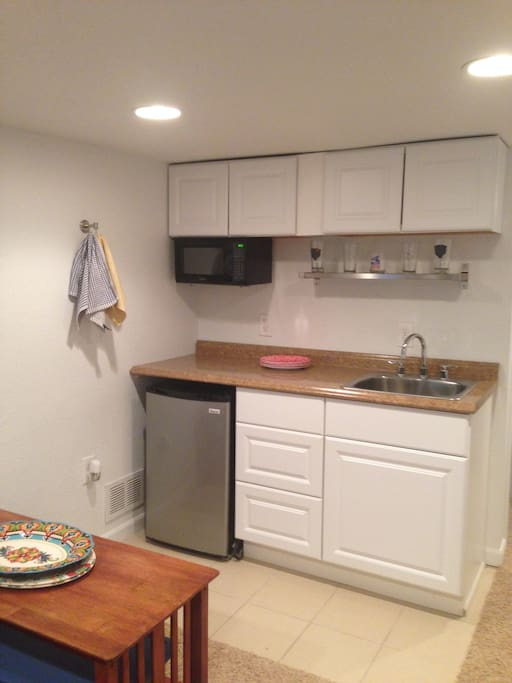 Kitchenette includes a sink, microwave and mini-fridge.