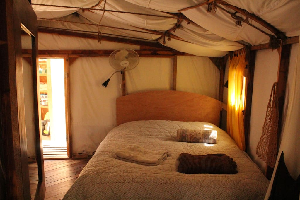sleeping room made of curved wood and cotton