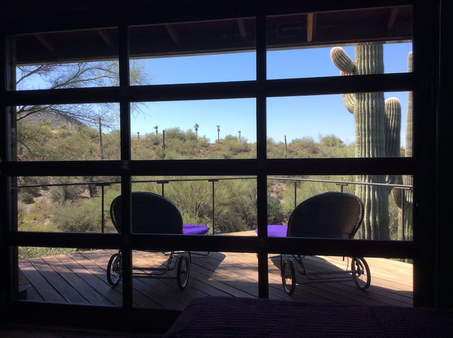 A view from the bedroom area of the interior loft with its own deck space with chaises to relax on while taking in the beauty of the desert....