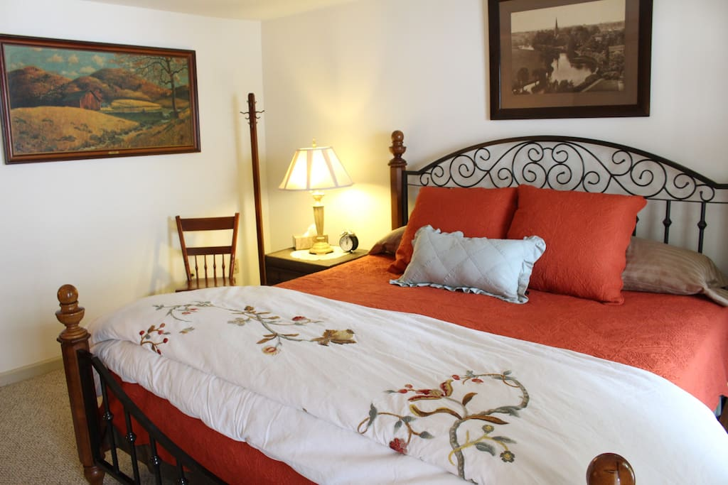 King bedroom with upgraded down comforter and linens