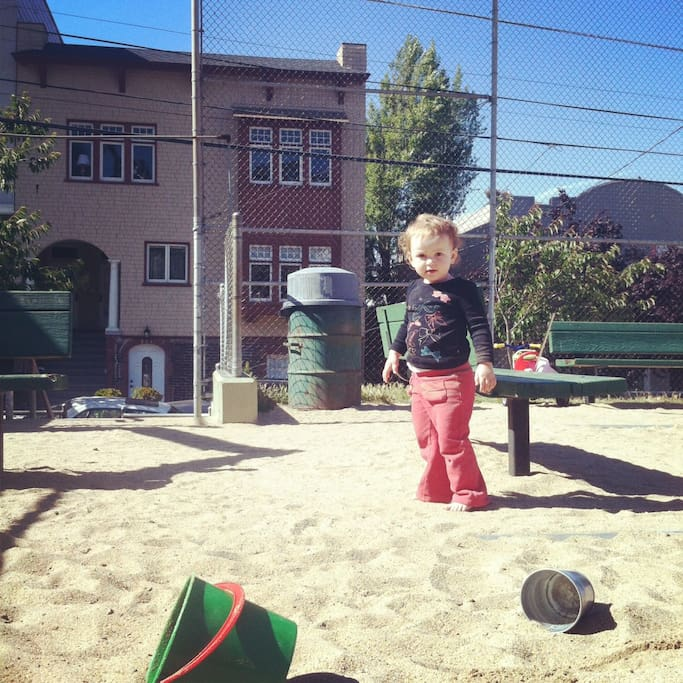 Taken at the playground across the street. You can see our cozy bay window in the background.