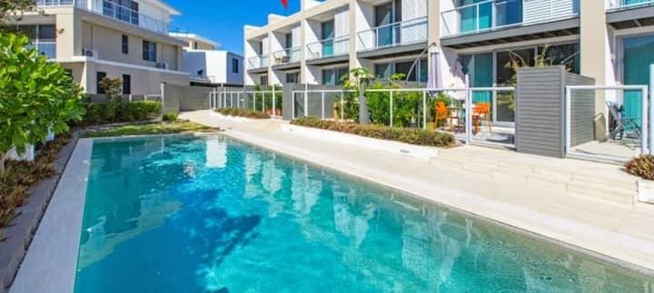 Stylish Beachside Townhouse with Swimming Pool