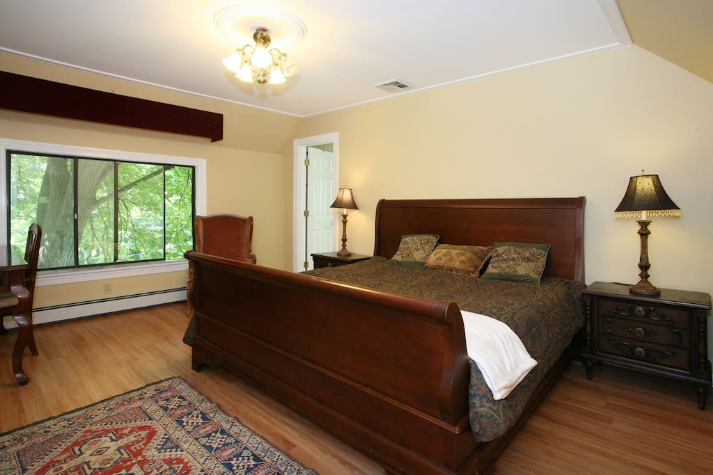 Large bedroom with king sized bed and private full bathroom