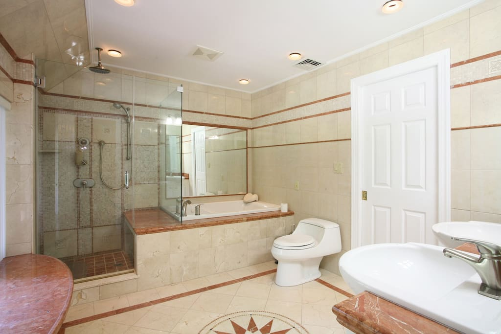 Your private bath includes a jacuzzi tub, shower and double sink