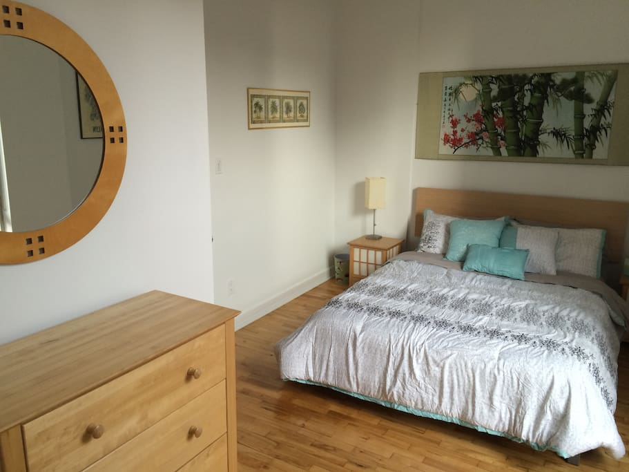 Guest Bedroom with dresser and mirror