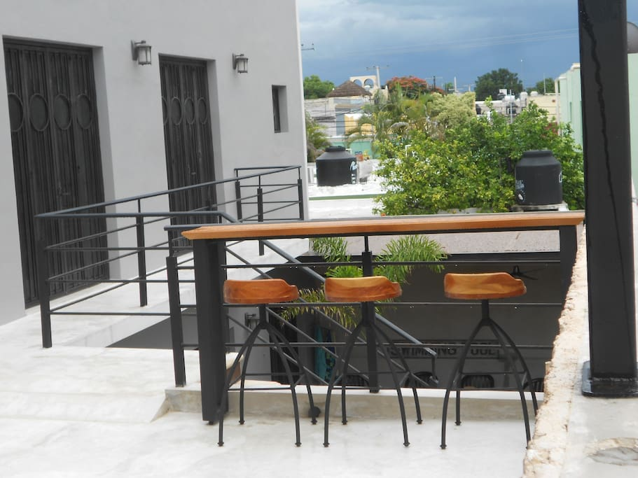 Nice bar/dining area outside the apartment - covered pergola with a sectional lounge sofa behind this