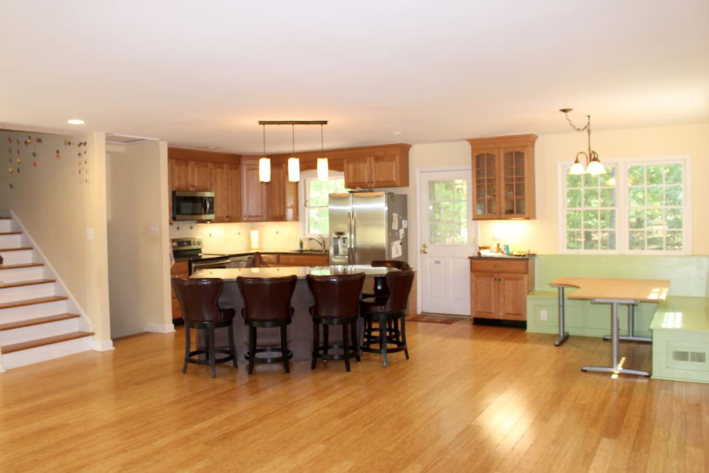 Tons of kitchen space to cook, relax and socialize including a cute little breakfast nook overlooking the woods.