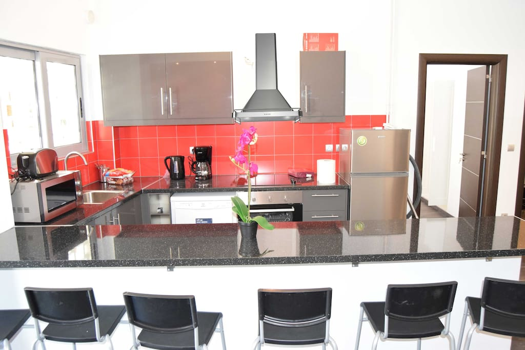 Kitchen with Fridge Freezer, Dishwasher, Oven, Microwave in bront of 3.5 metre breakfast bar.