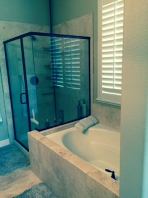Upgraded Bathrooms with Travertine, Iron bronzed accents