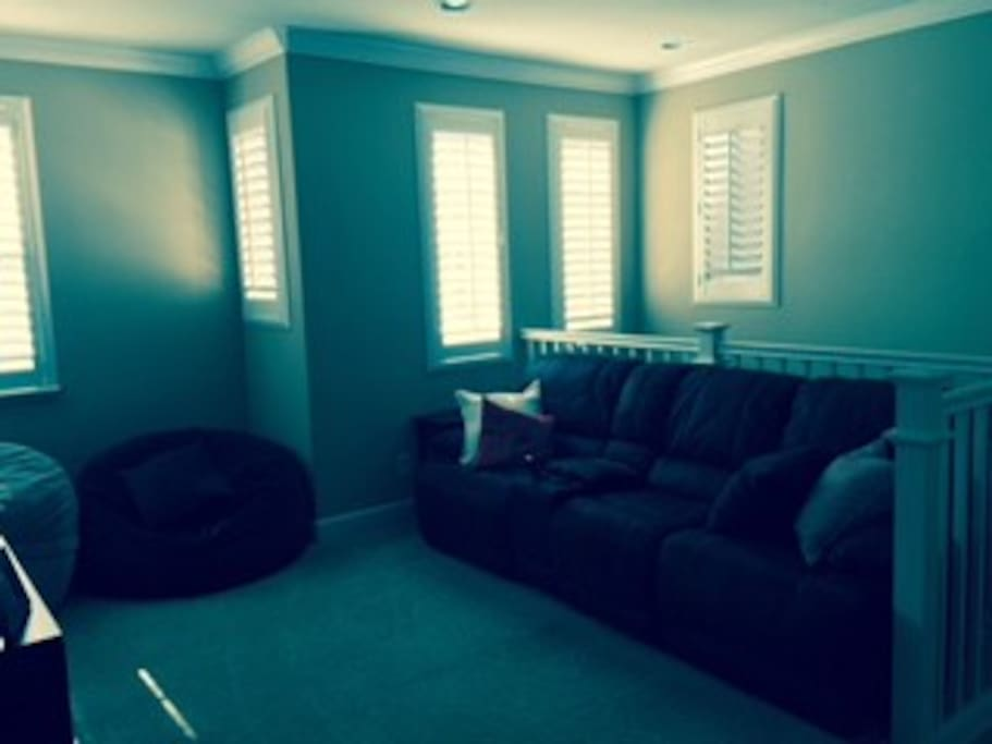 """Upstairs Den with reclining sofas, bean bags & 50"""" TV"""