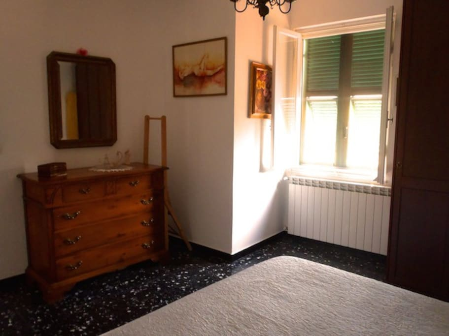 Bright room with large window. All windows have new mosquito nets and shutters.
