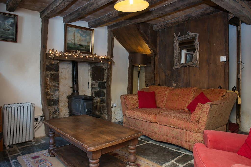 Main lounge with wood burning stove