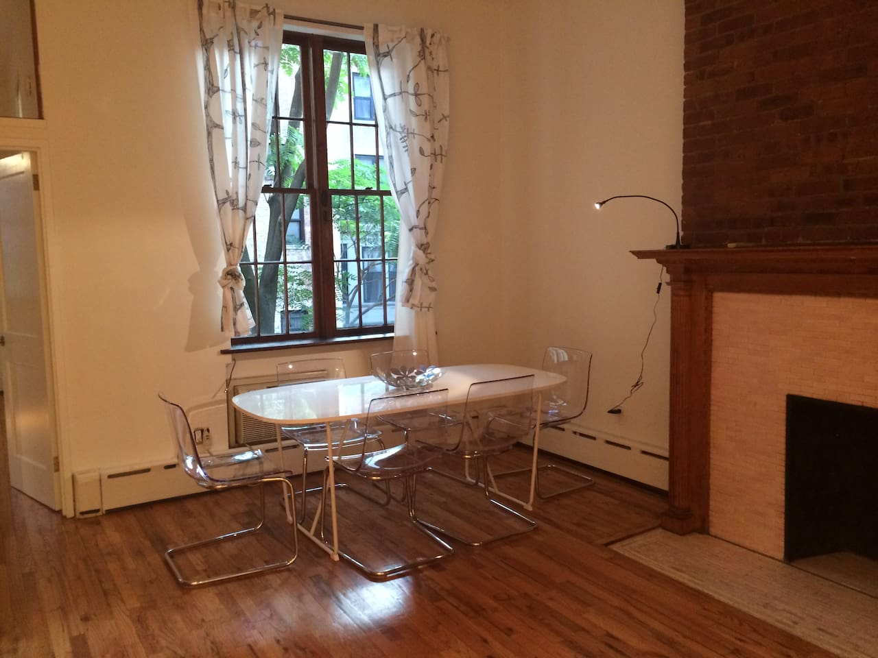 Dining table seats 6, decorative fireplace in living, mounted TV above