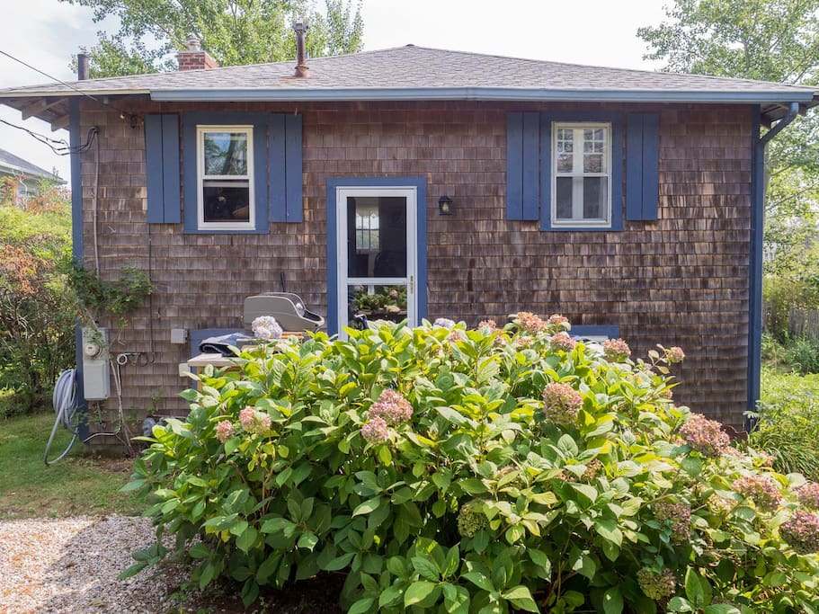 Cottage front view of one story living, bungalow style.
