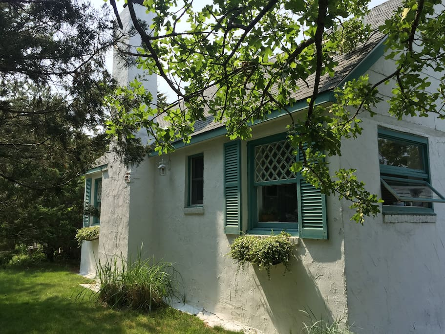 Front side of the English Cottage with flower boxes