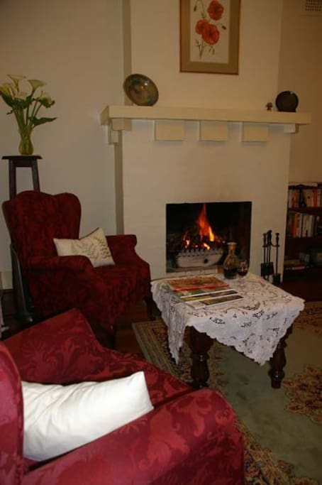 Relax and enjoy the cosy living room with open fireplace