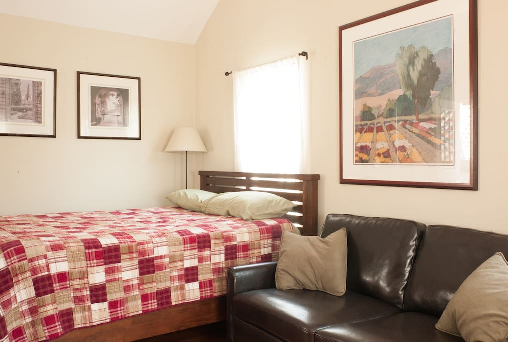 The queen sized bed and leather sofa-both comfy places to relax