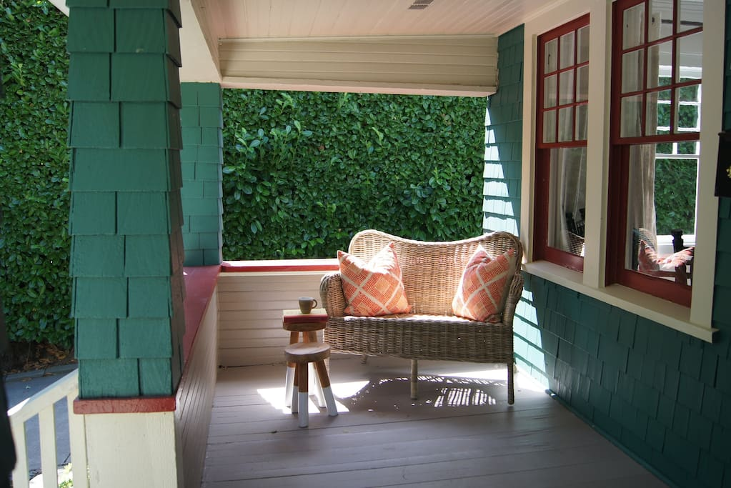 A large, covered patio is the perfect place to enjoy a cup of tea and a good book.