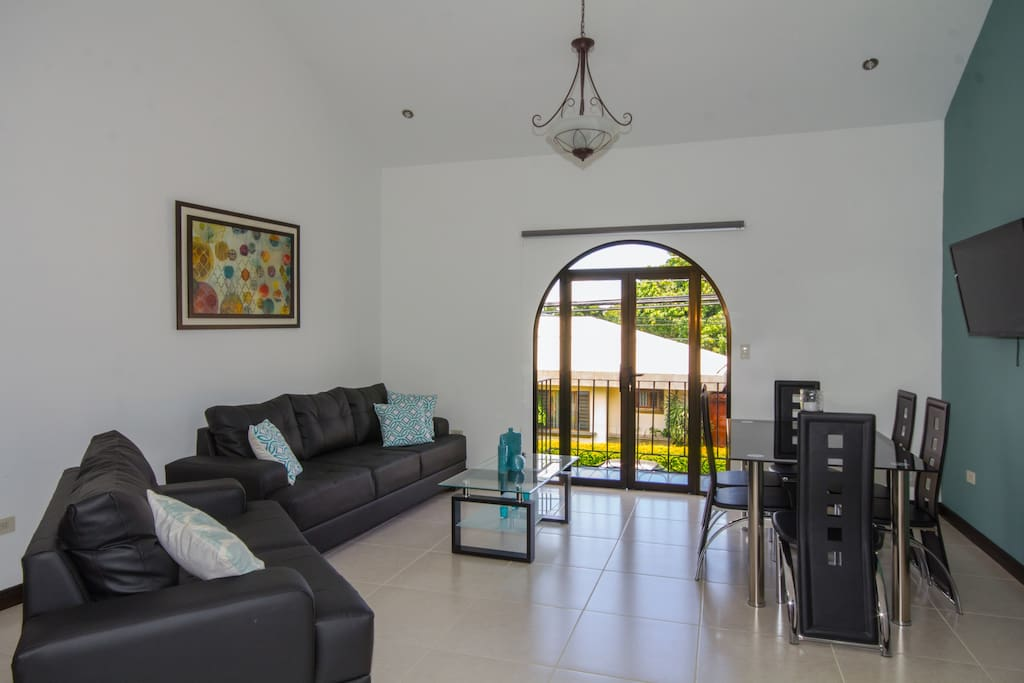 Spacious living & dining area with flat screen tv & access to balcony