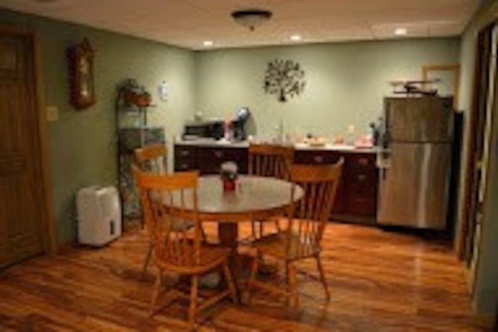 Kitchenette and dining area.  Features a full sized refrigerator, microwave, toaster oven and crock pot.