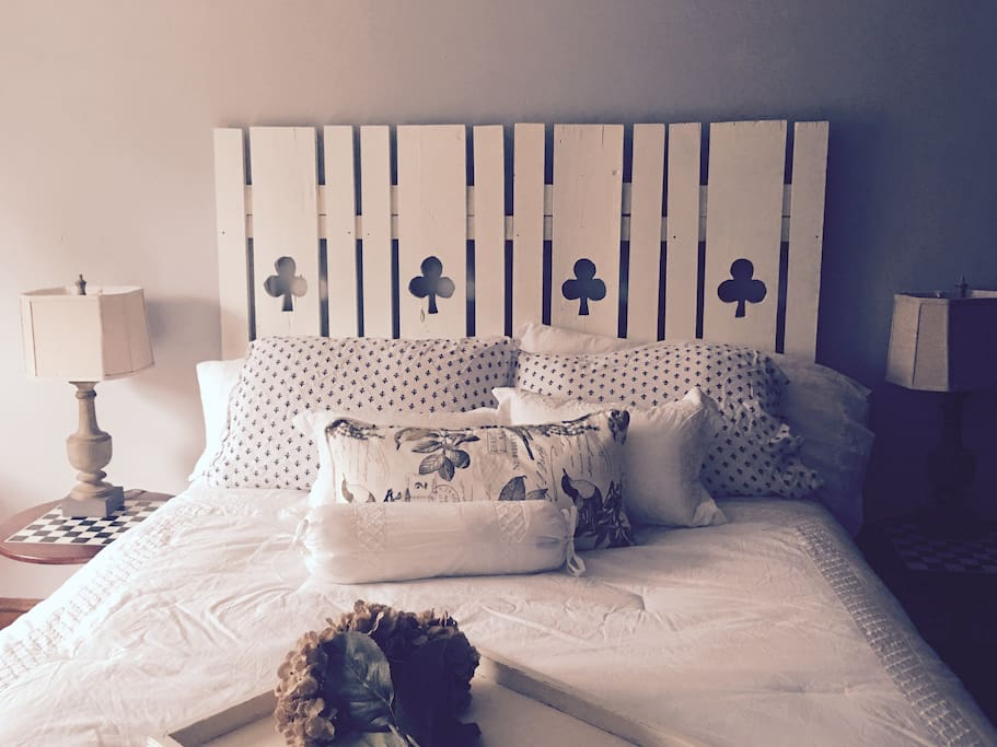 3rd-floor queen bed with headboard we built with vintage shutters found at an antique store. Soft blanket in room and down comforter available.