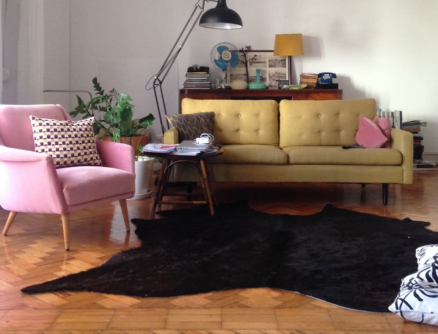 We love to come at the sofa in the end of the day, talk about ideas, having a gin tonic and a light meal, tell about things, drawing in paper on the floor. It's our place for getting together. We love the flamingo vintage sofa - everything, every object h