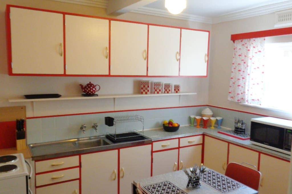 Kitchen - bright, clean and practical with a nod to its original maker
