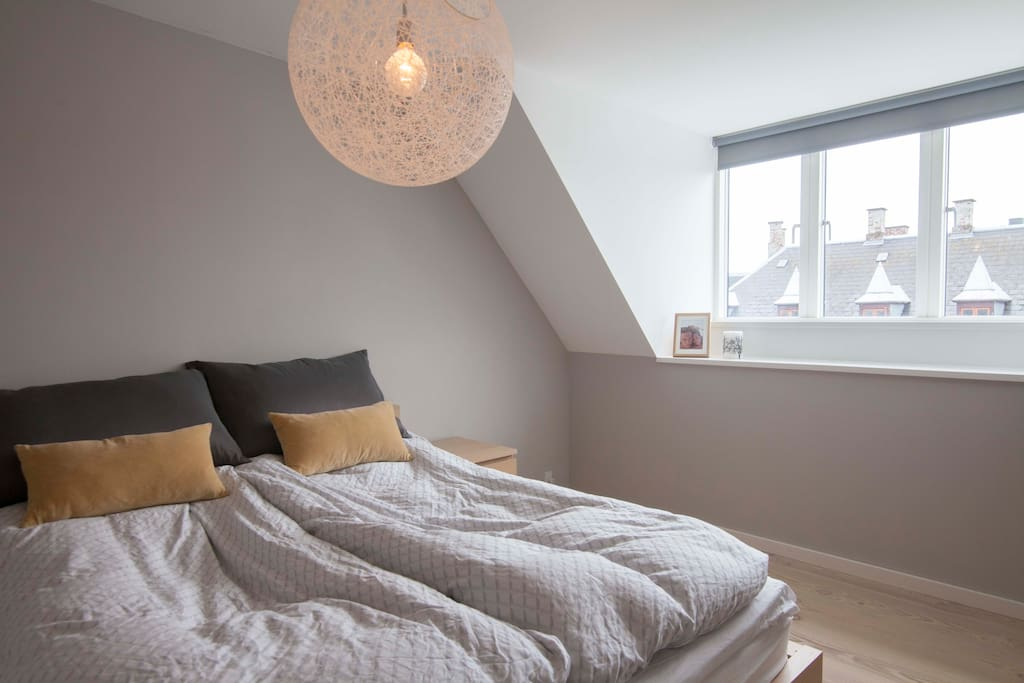 Large and light bedroom with dark curtains for a good nights sleep