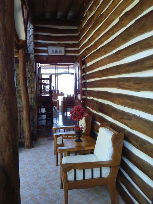 Another inspiration of the resort that gives you the access going to the lower rooms and to the sala. Still decorated with logs/wood products.