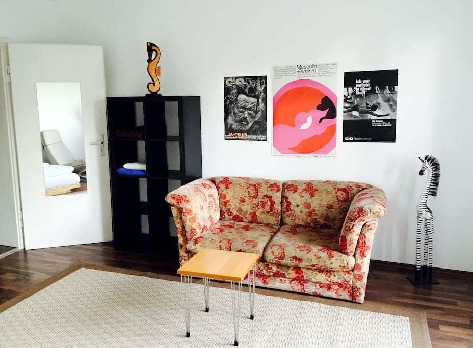 There is now a little couchtable and some posters on the wall