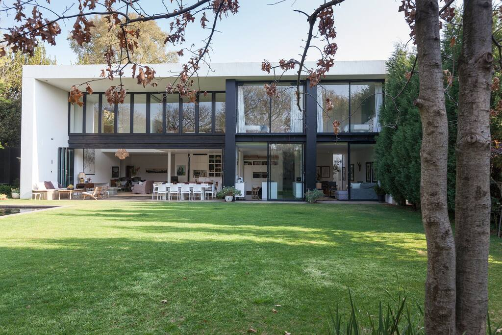 A contemporary home with all rooms facing a sunny large garden designed by award-winning architect Enrico Daffonchio