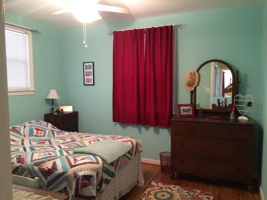 "This is the guest room.  It is a full size bed with a very comfortable mattress!  I have a different spread on it now, because that one got a little too ""vintagey."""