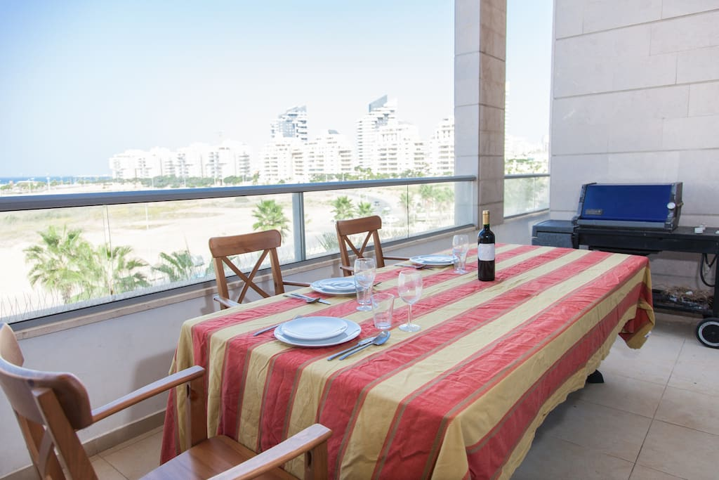 Large terrace with dining table and Weber BBQ