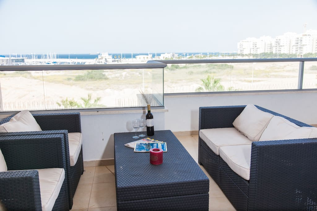 Relax on the Large terrace with dinning table, couch and large Weber BBQ