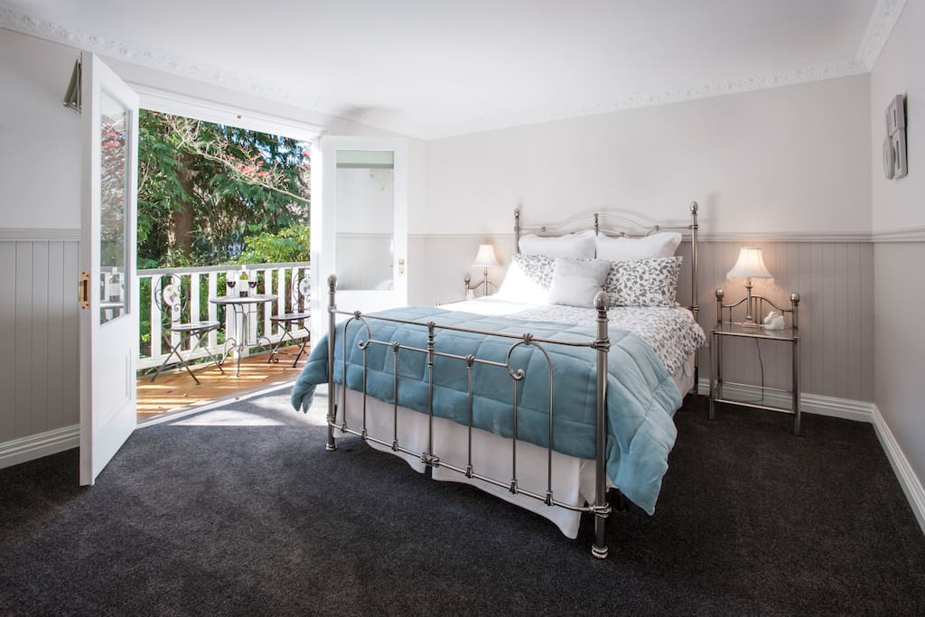 The Stables main bedroom opens to a private deck.