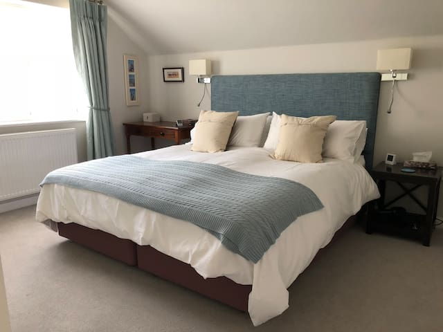 Master bedroom with superking size bed.