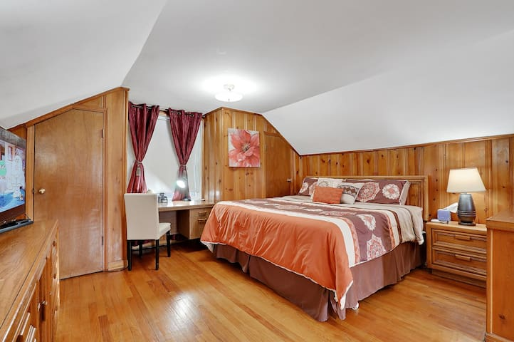 Huge size master bedroom with king sized bed, night stand, 3 table lamps, new comforter, additional thin quilt, new big LED Samsung TV, Bluetooth music player, chest, dresser with 2 mirrors, desk, chair, walk-in closet, second closet, safe , A C fan