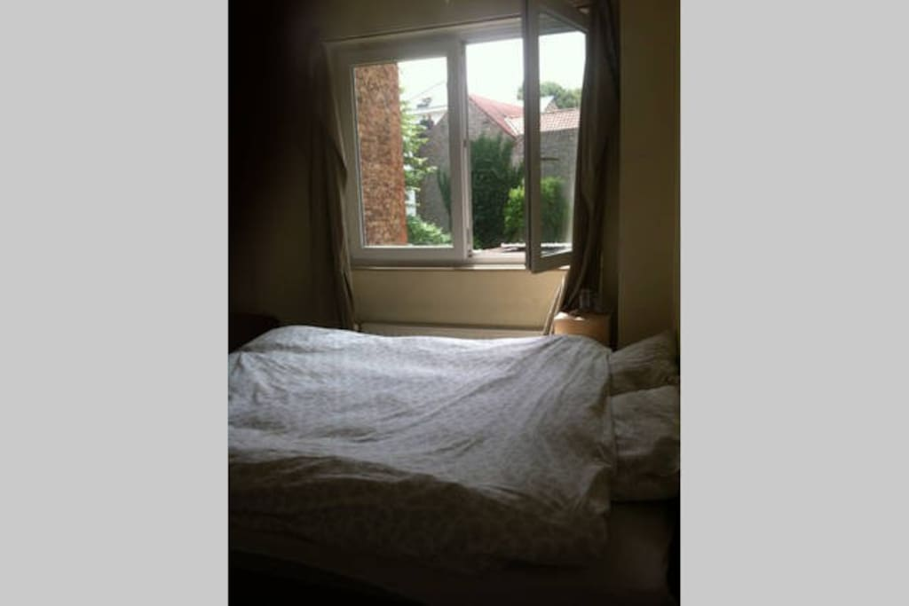 Double bed with a nice window.