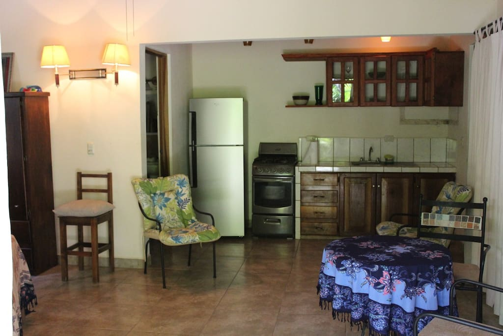 Kitchen with gas stove and fridge.