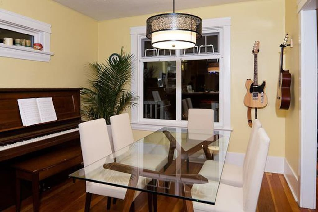 Guitars to play and upright grand piano in dining room