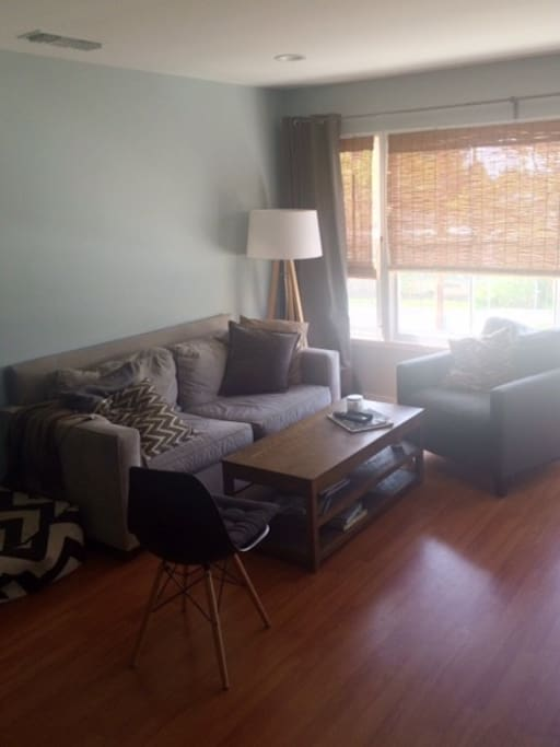 Large windows let in a ton of sunlight. It is bright and sunny all day long. TV with AppleTV is also in the living room.