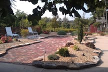 A view of the garden from the fireplace cabana. We are located in the middle of 5 acres with farmland on 3 sides of us.