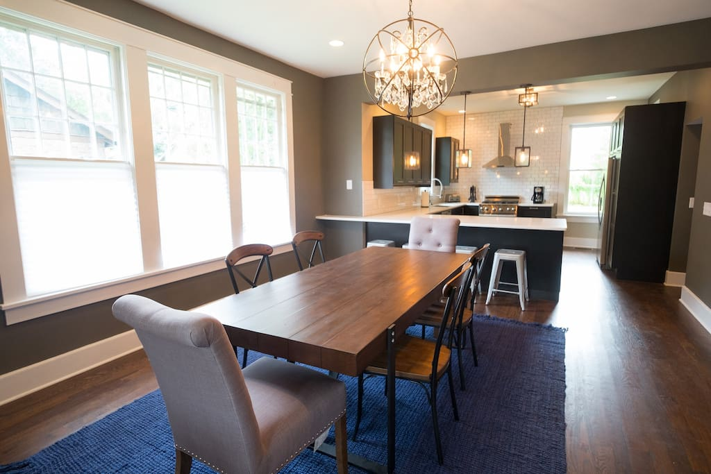 Huge, open dining and kitchen space flow into the living room.