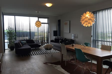 Beautiful brand new one bedroom apartment in Garðabær with a lovely decor and amazing view over Reykjavík and Reykjanes.   The apartment has a private balcony and can sleep 4 to 5 persons.  Reykjavik downtown is only 10 minutes away with a car.