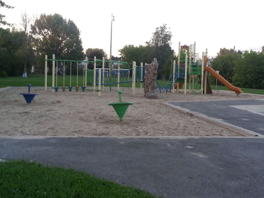 Children's park beside house with soccer field