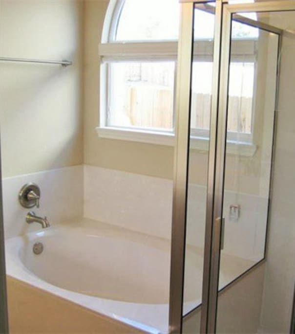 Oversized tub and separate shower in the master